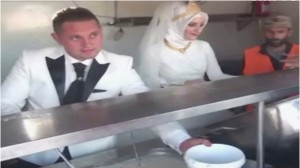 couple feeds the hungry at wedding